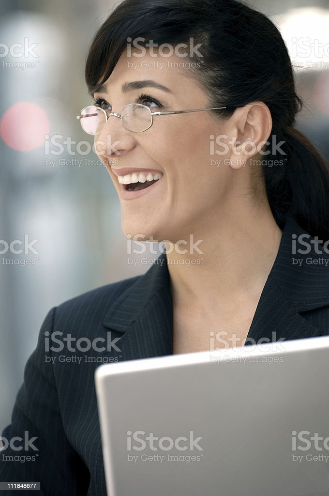 Teacher or Businesswoman Wearing Glasses Holding Laptop Computer royalty-free stock photo