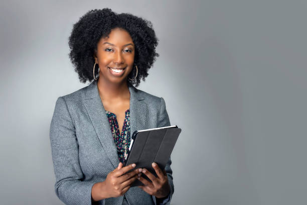 Teacher or Businesswoman with Tablet stock photo
