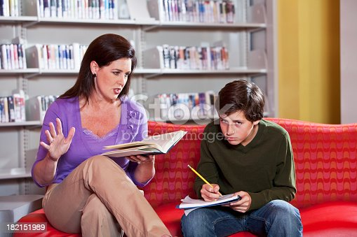 istock Teacher or parent helping student 182151989