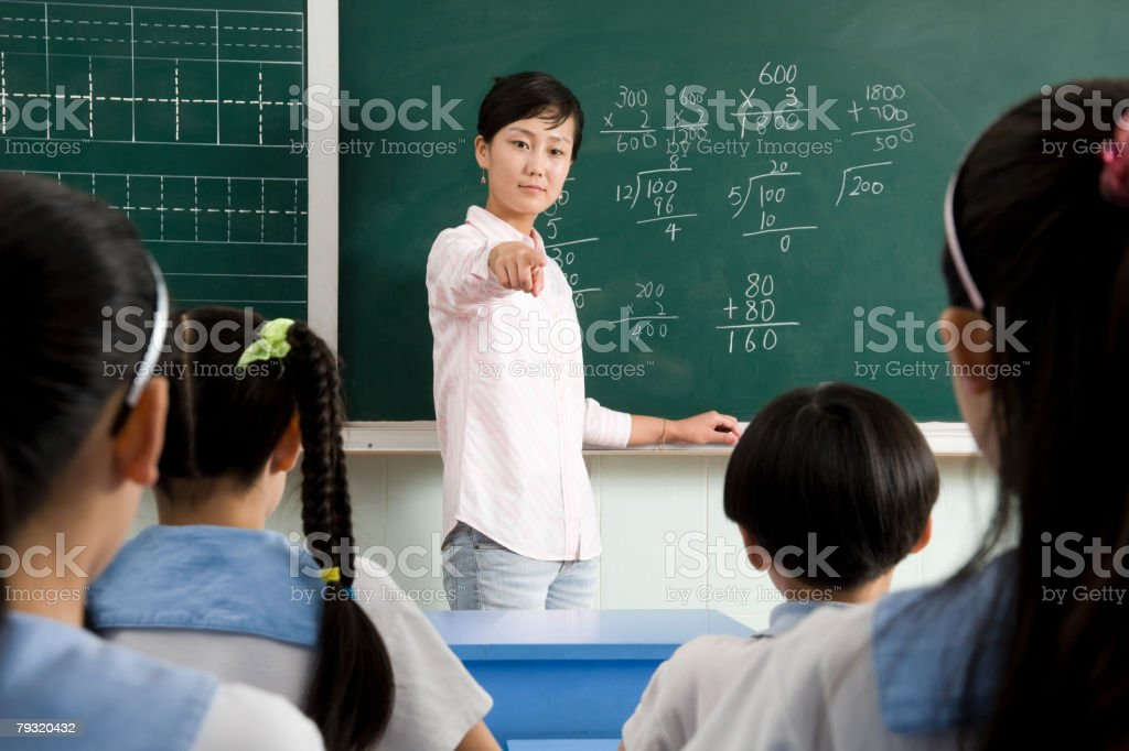 A teacher pointing at a student 免版稅 stock photo