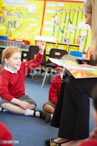 181085327 istock photo Teacher Reading Story To Elementary School Pupils 181081193