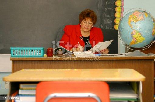 868148002 istock photo Teacher Series: Grading Papers 182146487