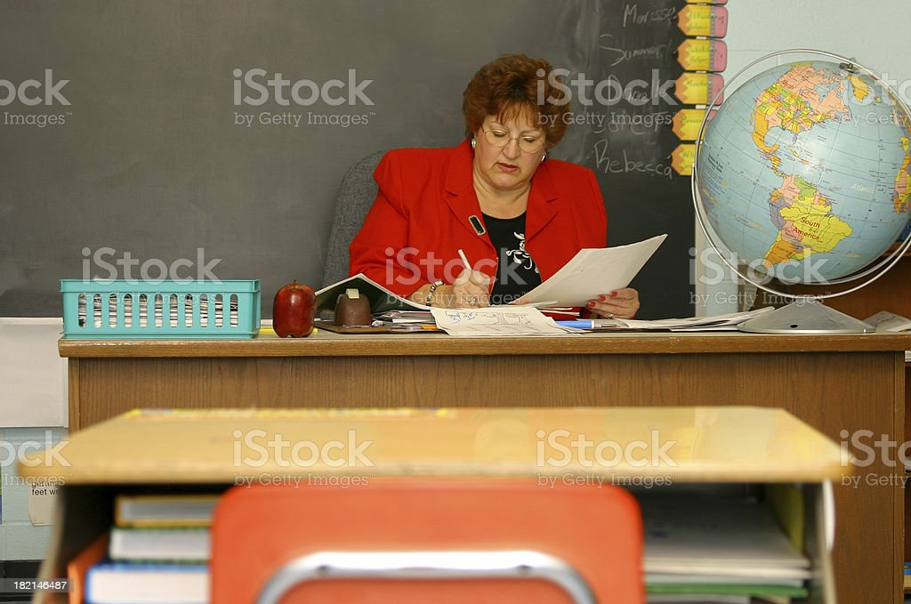 Teacher Series: Grading Papers stock photo