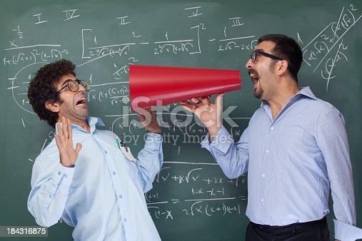 istock Teacher shouting at nerd student for mathmatics 184316875