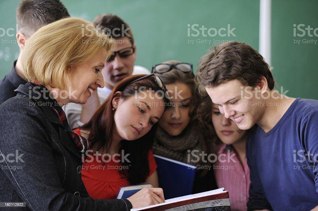 Teacher showing a book stock photo