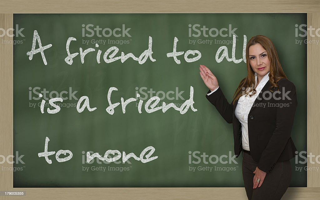 Teacher showing A friend to all is none stock photo