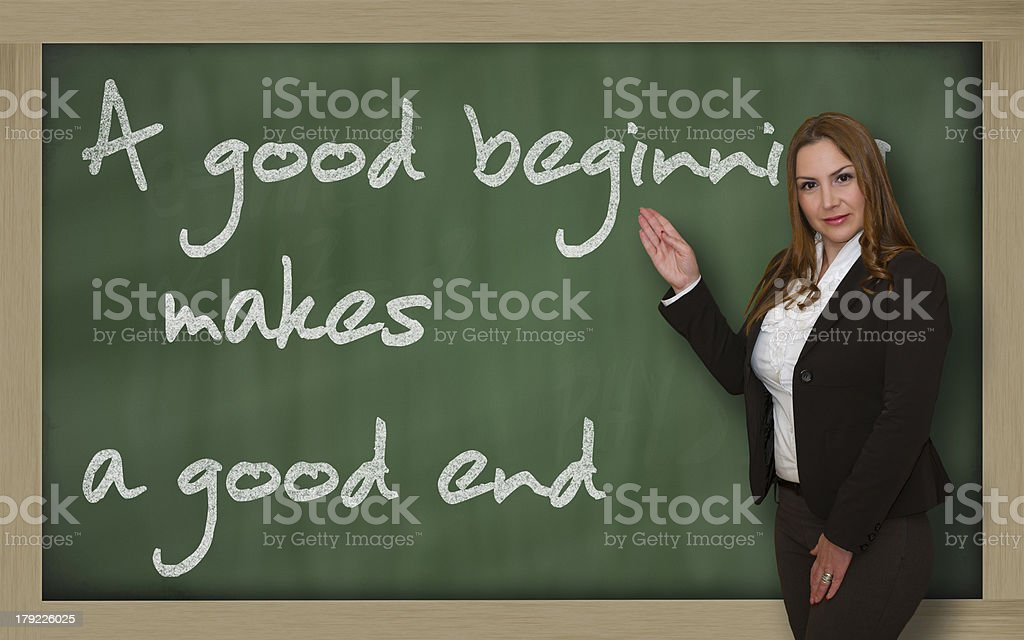 Teacher showing A good beginning makes end stock photo