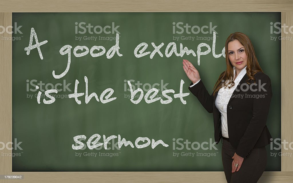 Teacher showing A good example is the best sermon stock photo