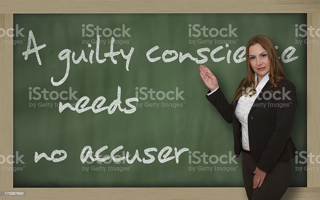 Teacher showing A guilty conscience needs no accuser stock photo