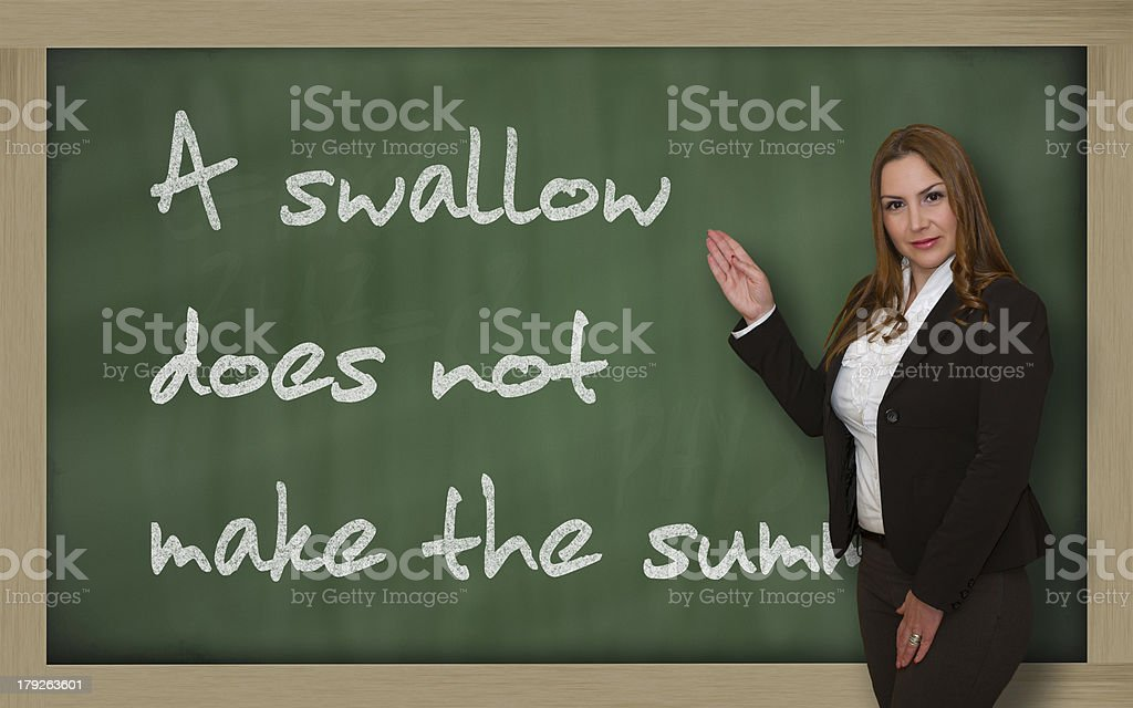 Teacher showing A swallow does not make the summer stock photo