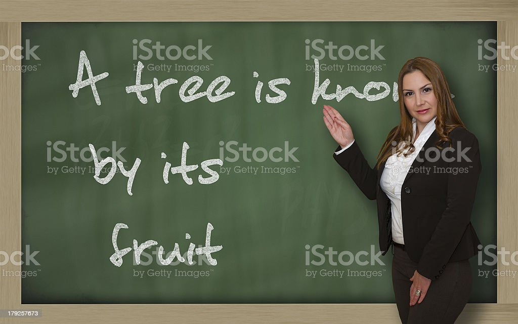 Teacher showing A tree is known by its fruit stock photo