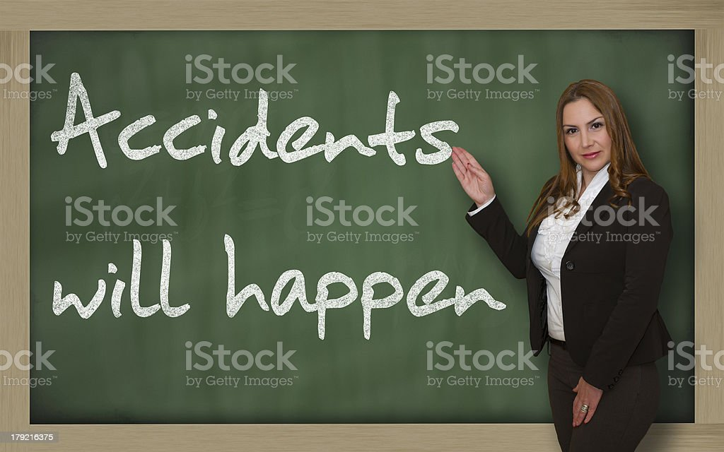 Teacher showing Accidents will happen on blackboard stock photo