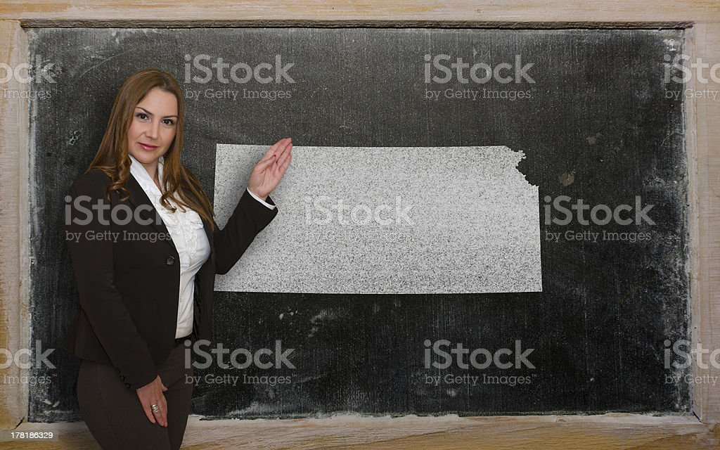 Teacher showing map of kansas on blackboard royalty-free stock photo