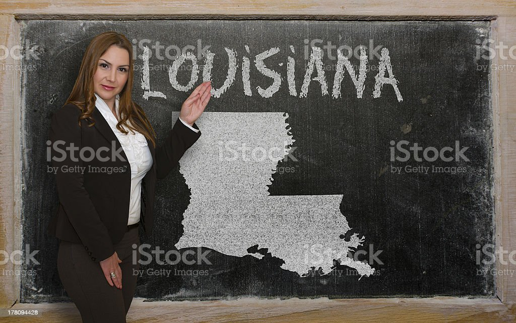 Teacher showing map of louisiana on blackboard royalty-free stock photo