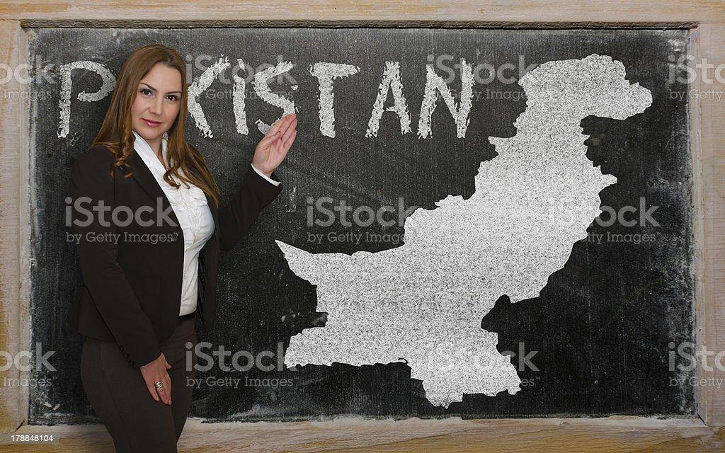 Teacher showing map of pakistan on blackboard stock photo
