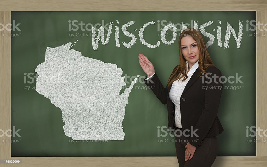 Teacher showing map of wisconsin on blackboard royalty-free stock photo