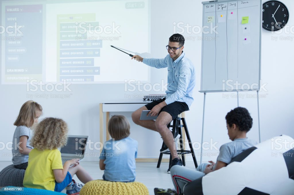 Teacher shows on an interactive whiteboard stock photo