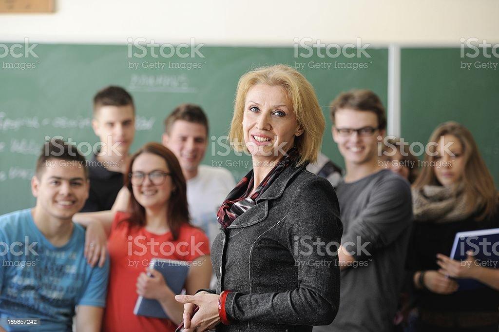 Teacher smiling in classroom stock photo