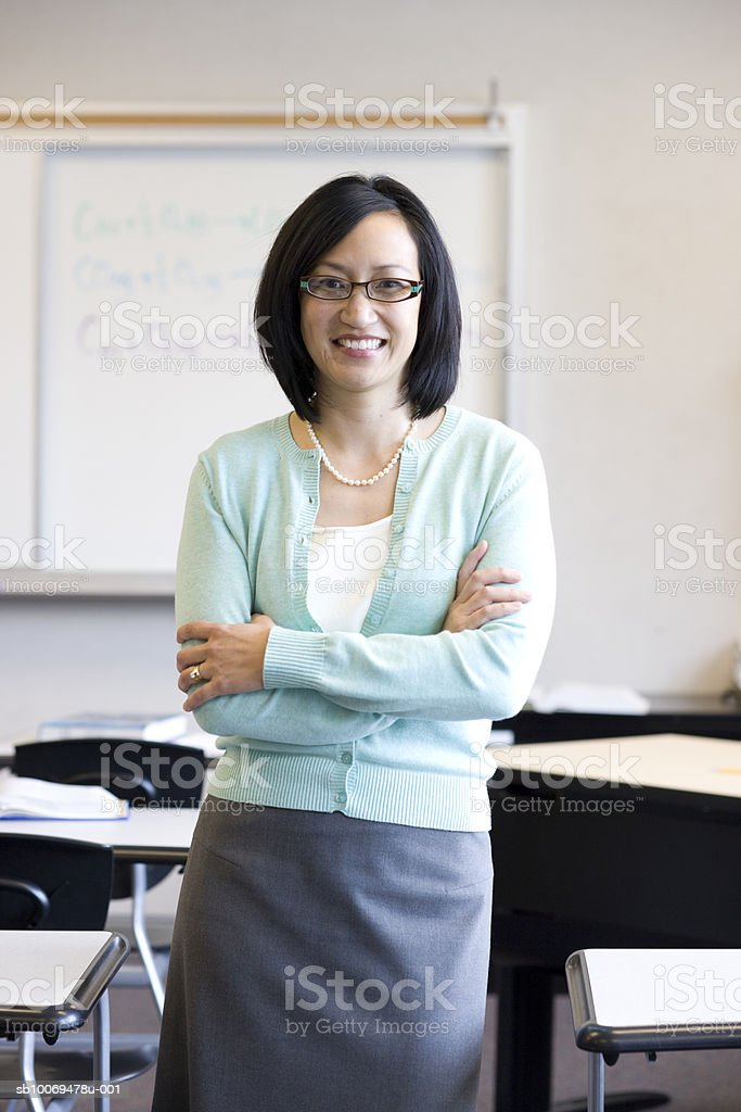 Teacher smiling in classroom, portrait royalty-free stock photo