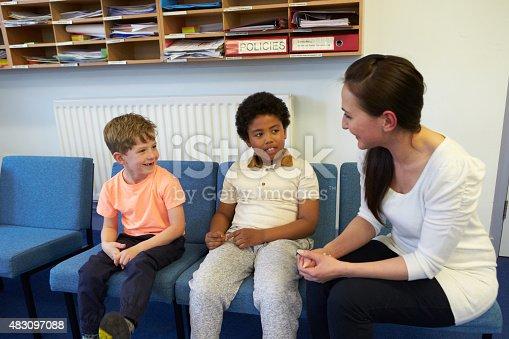 istock Teacher Solving Problem Between Two School Students 483097088