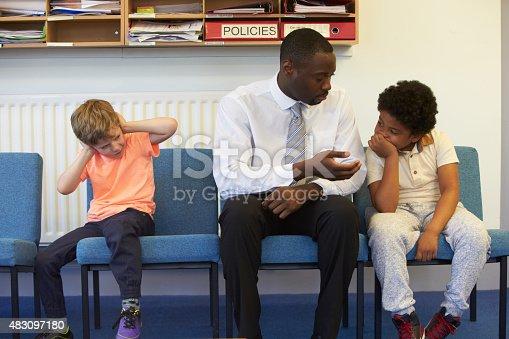 istock Teacher Solving Problem Between Two School Students 483097180