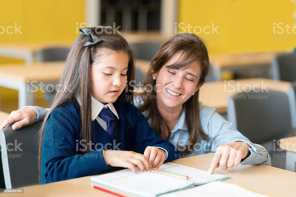 Teacher talking to students at the school stock photo