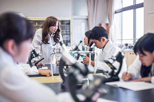 457224763 istock photo Teacher talking with her students in the Science Lab 481189864