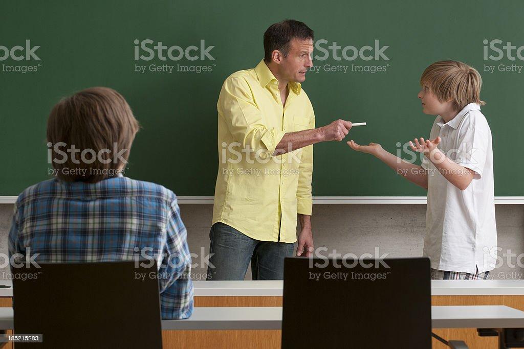 teacher talking with student stock photo