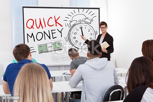 istock Teacher Teaching Graphs To College Students 921349568