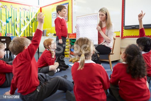 1160928955 istock photo Teacher Teaching Maths To Elementary School Pupils 181047089