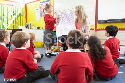 1160928955 istock photo Teacher Teaching Maths To Elementary School Pupils 181048500