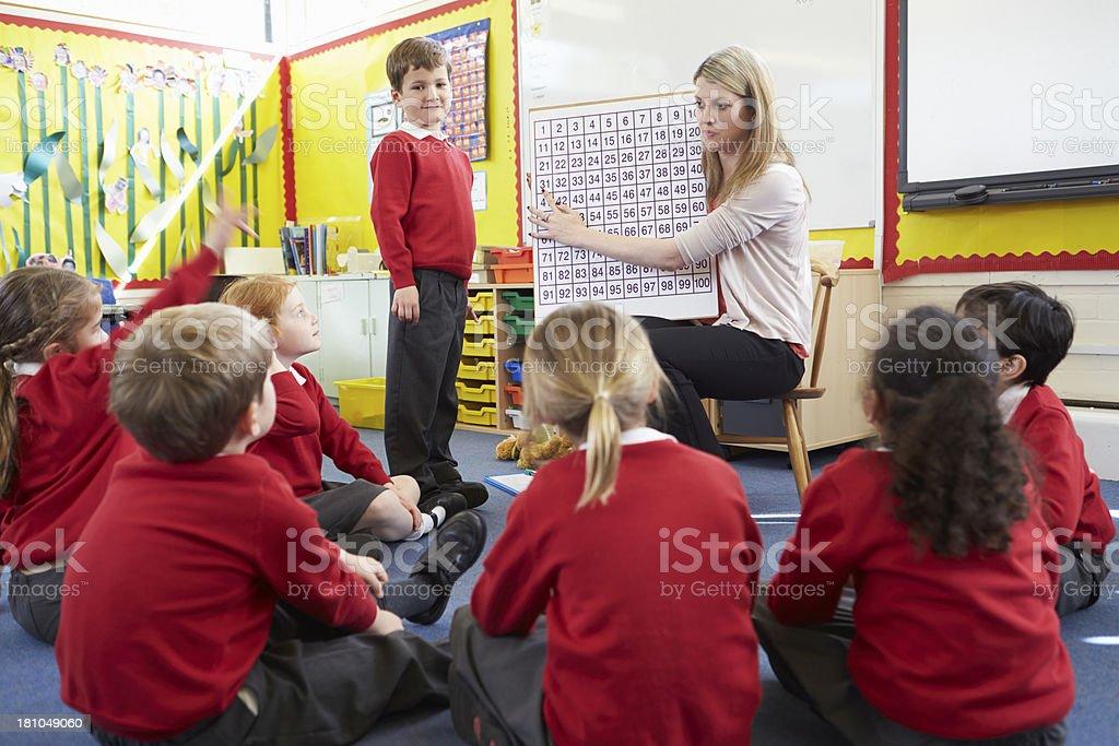 Teacher Teaching Maths To Elementary School Pupils royalty-free stock photo
