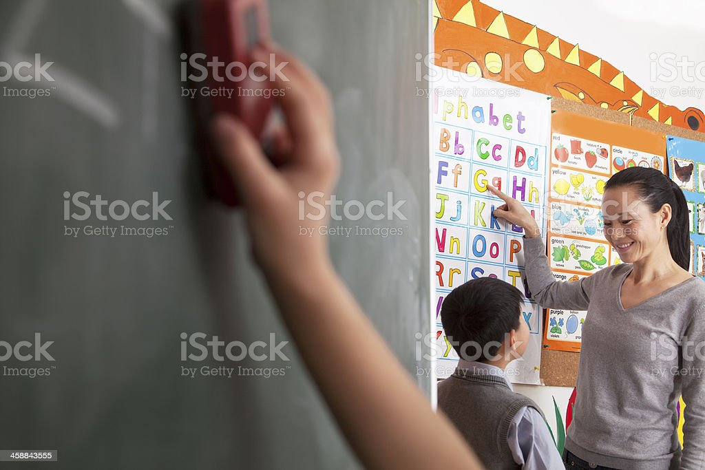 Teacher teaching student the alphabet stock photo