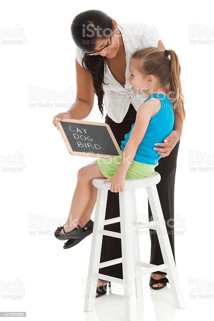 Teacher Teaching Young Girl To Read royalty-free stock photo