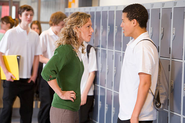 Teacher Telling A Student Off  punishment stock pictures, royalty-free photos & images