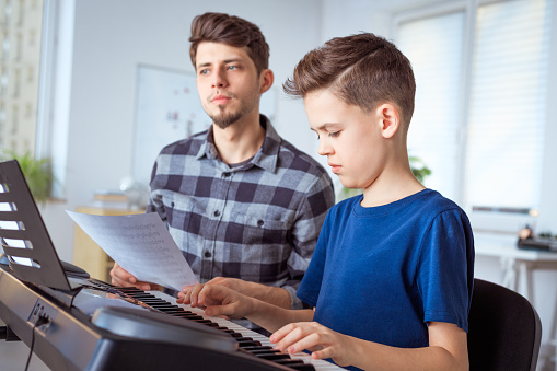 Teacher Training Boy In Learning Piano Stock Photo - Download Image Now