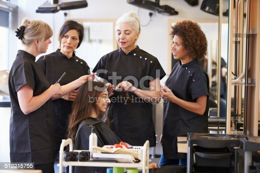 istock Teacher Training Mature Students In Hairdressing 512215755