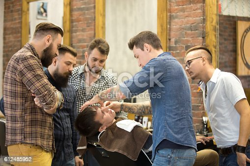 istock Teacher training students in beard shaving 612485952