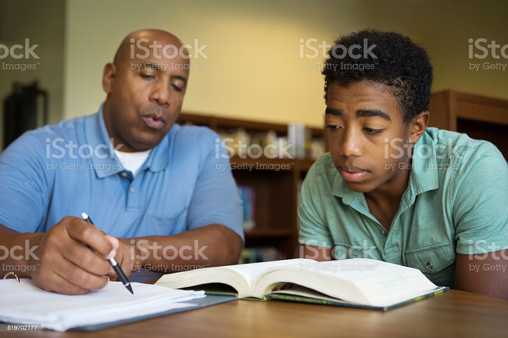 Teacher tutoring a student stock photo