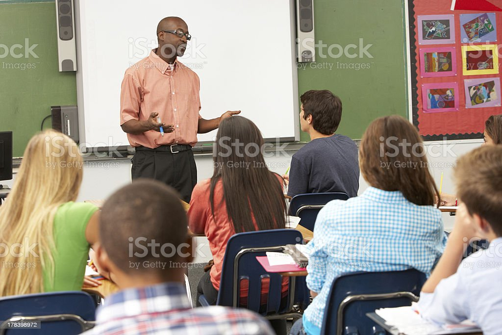 Teacher using interactive whiteboard during class stock photo