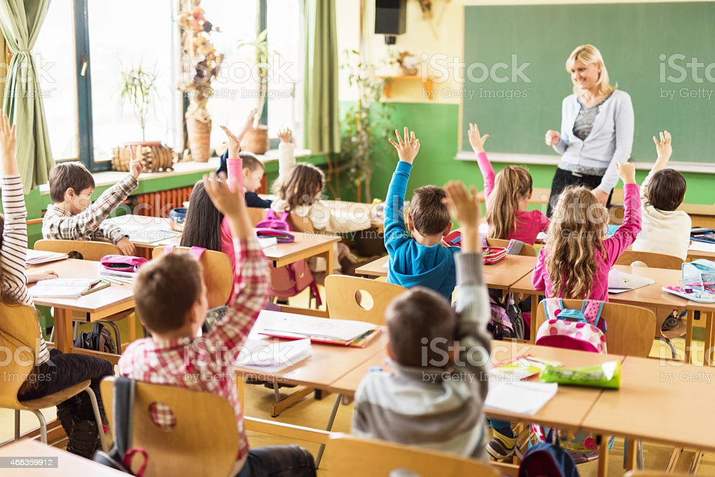 Teacher, we all know the answer! royalty-free stock photo