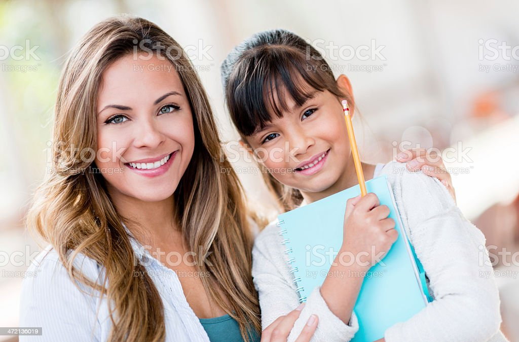 Teacher with a student at school stock photo