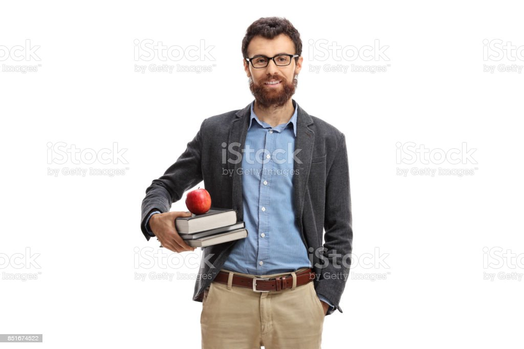 Teacher with an apple and books looking at the camera stock photo