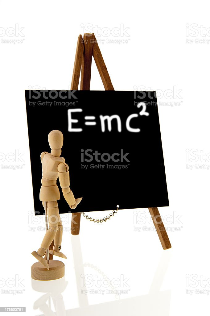 Teacher with blackboard and equation of relativity royalty-free stock photo