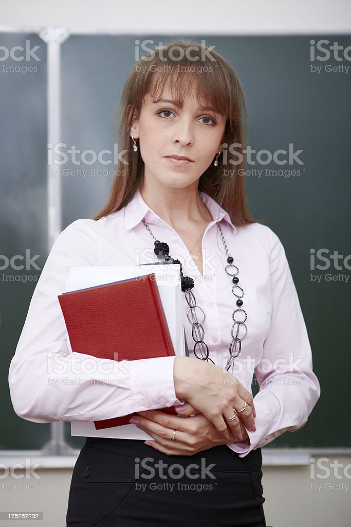 Teacher with books royalty-free stock photo