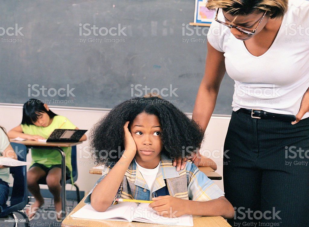 Teacher with bored child royalty-free stock photo