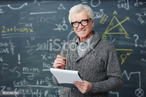 istock Teacher with document 905256730