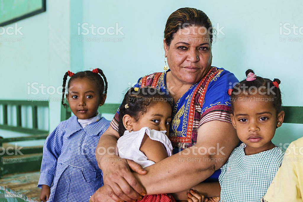 Teacher with goup of children in Southern Egypt stock photo