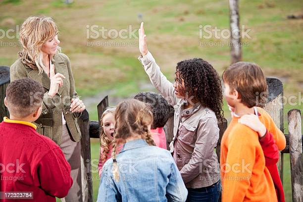 Teacher With Group Of Children At Zoo Stock Photo - Download Image Now