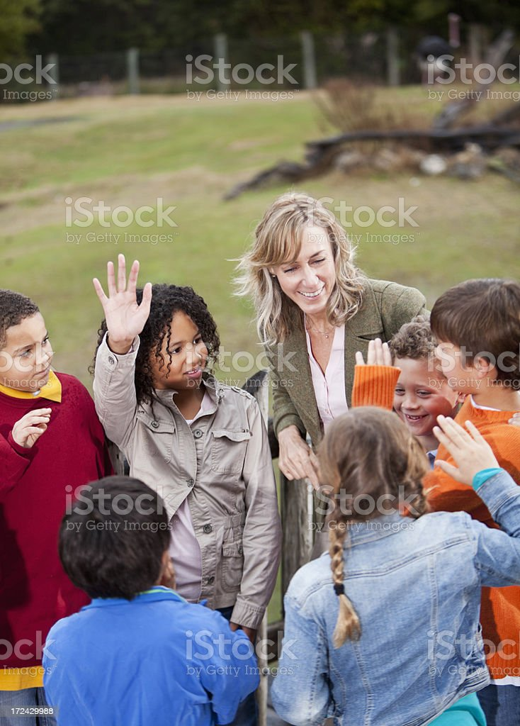 Teacher with group of children at zoo stock photo